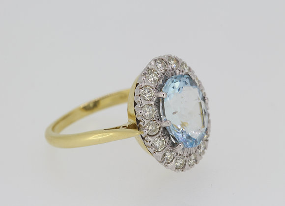 Aquamarine and diamond cluster ring a6.50cts d.80cts