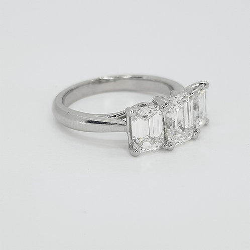 Platinum Emerald cut three stone.