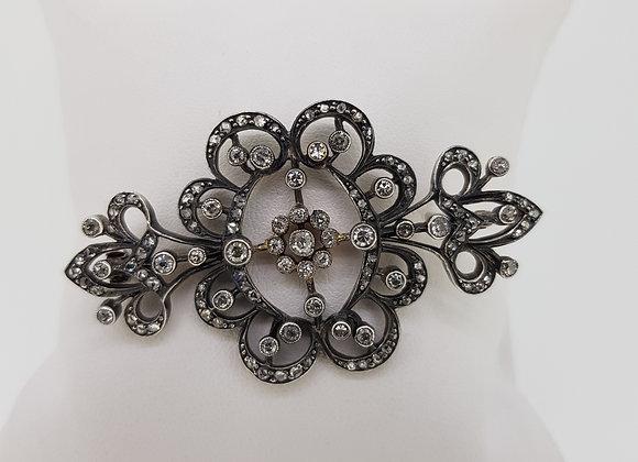 Victorian silver set gold backed diamond brooch.