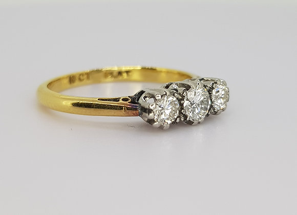 Three stone diamond ring.