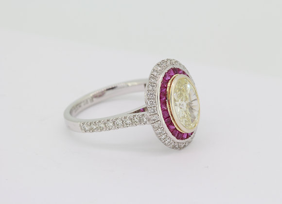 Oval fancy yellow diamond D1.51cts certified with calibre rubies