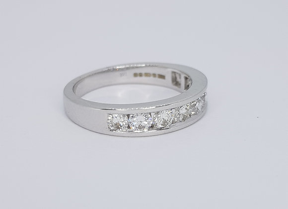 Channel set 1/2 eternity ring. D0.80cts