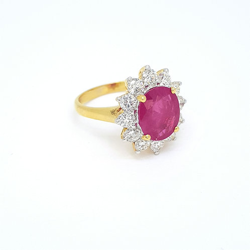 Traditional ruby diamond cluster ring.