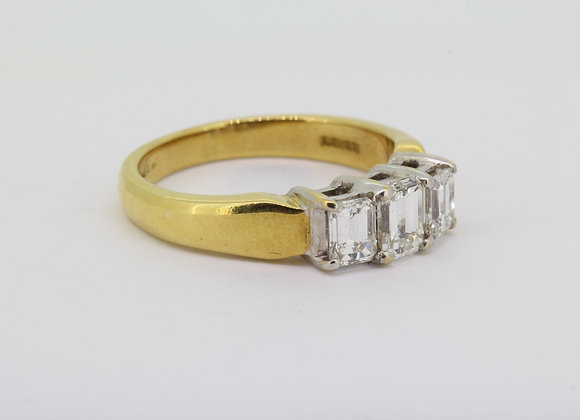 Emerald cut three stone diamond ring.