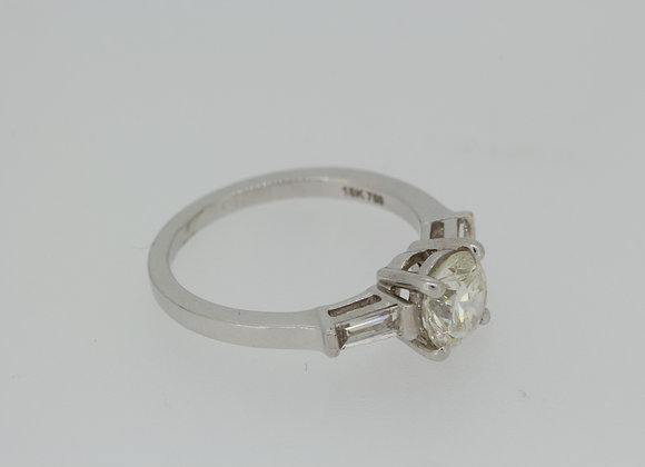 Solitaire with baguettes diamond ring.