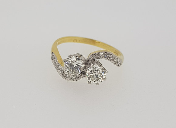 Twin diamond cross over ring.