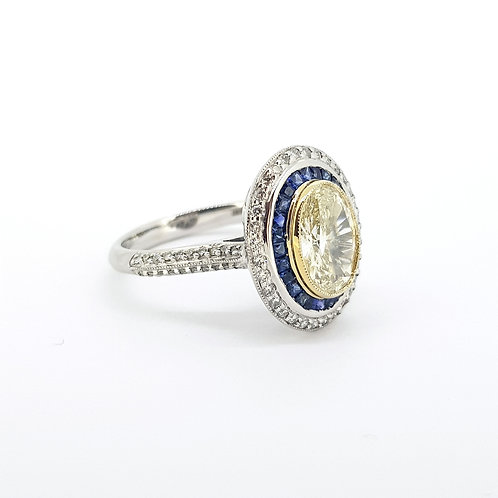 Fancy yellow diamond certed 1.06CTS set with sapphires and diamonds
