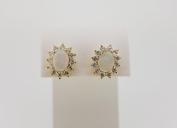 Opal and diamond cluster stud earrings.