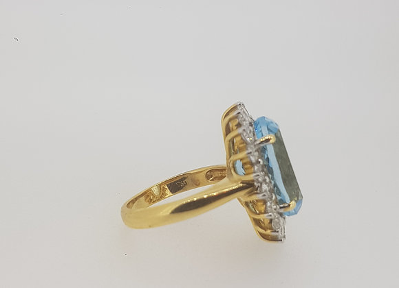 Oval blue topaz and Diamond Cluster Ring