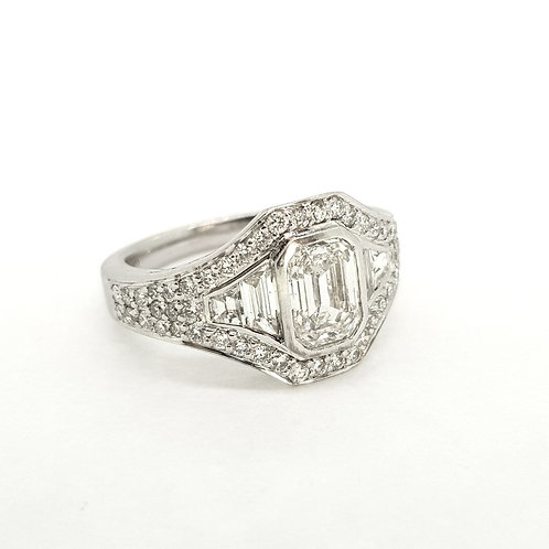 Cluster ring with central Emerald Cut Diamond