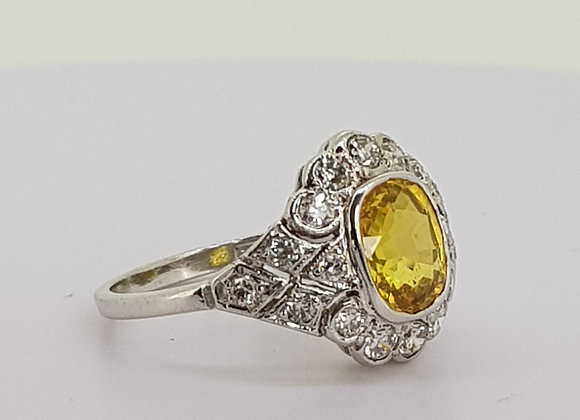Yellow sapphire and diamond ring.