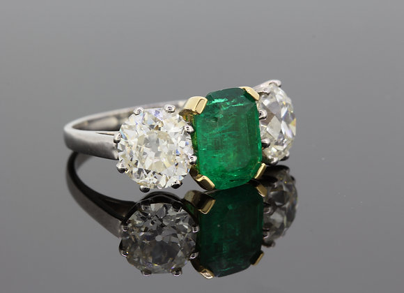 Columbian certified emerald and diamond 3 stone ring.