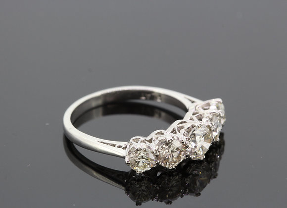 Platinum five stone diamond ring.
