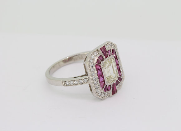 Ruby diamond calibre set platinum ring.
