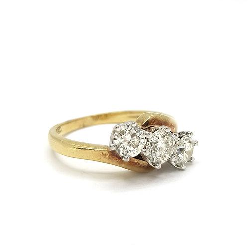 Diamond three stone crossover ring.