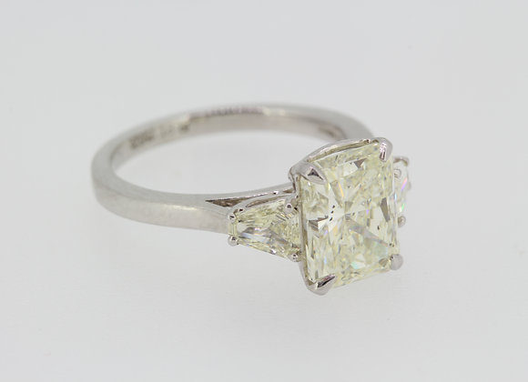 Platinum emerald cut diamond ring.