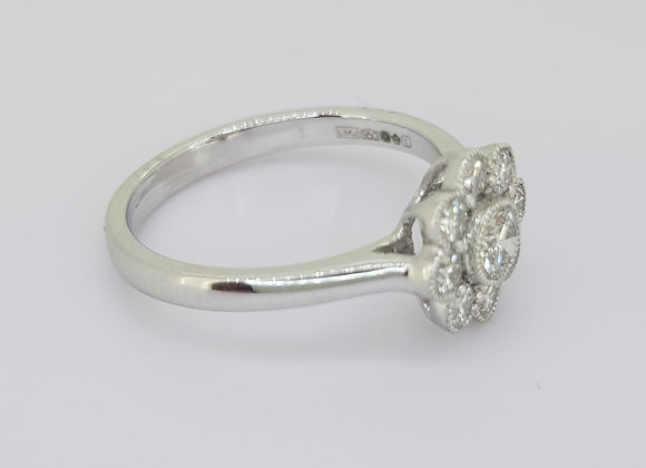 Daisy cluster diamond ring tdw0.57cts