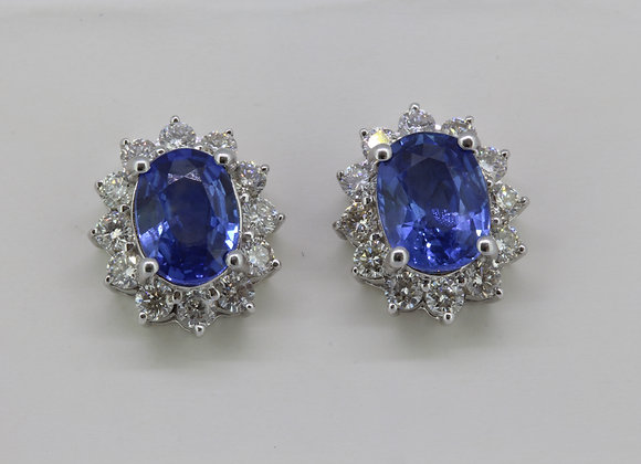Sapphire and diamond cluster earrings.