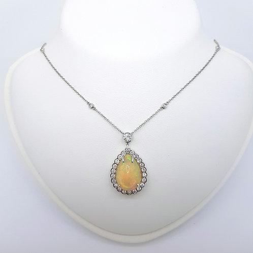 Opal and diamond pendant. Opal est.10.0CTS D1.80CTS