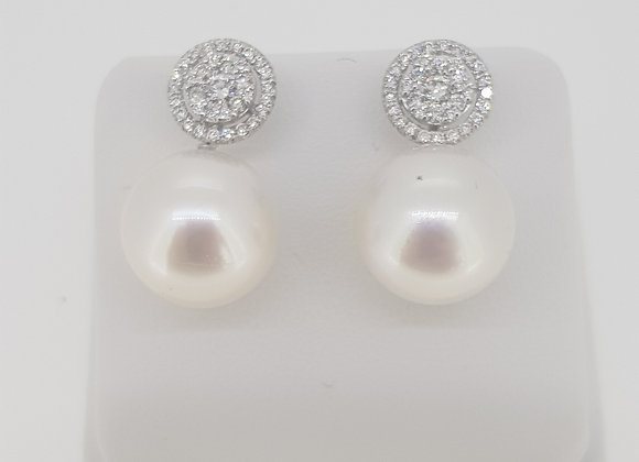 South sea pearl and diamond cluster top earrings.
