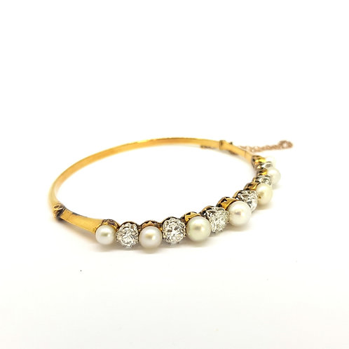Antique Natural pearl and diamond bangle.