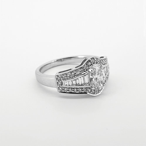 Oval diamond baguette brilliant cut ring D.70cts x .69cts 18ct
