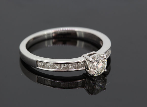 Diamond solitaire with princess cut diamond shoulders d.52cts x .43cts