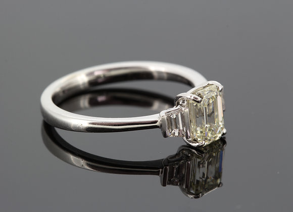 Emerald cut and baguette 18ct diamond ring.