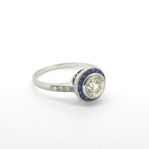 Calibre set sapphire and diamond target ring CD1.0Cts