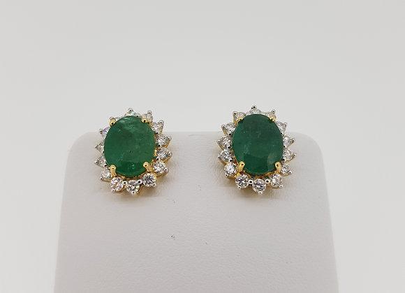 Emerald diamond cluster stud earrings.
