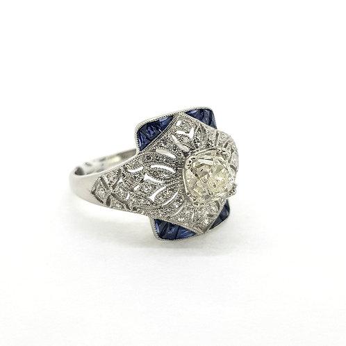 Calibre set sapphire and diamond ring centre old cut est.0.80Cts platinum