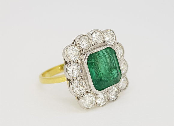 Columbian Emerald and diamond cluster ring. emerald 5.50cts d2.25cts