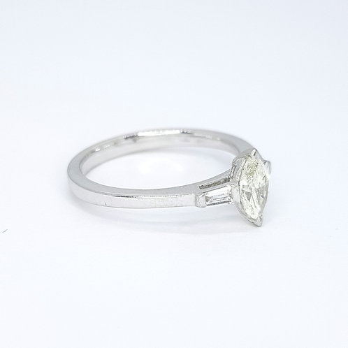 Marquee diamond with baguette shoulders ring.