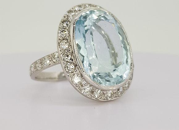 Aquamarine and diamond cluster ring.