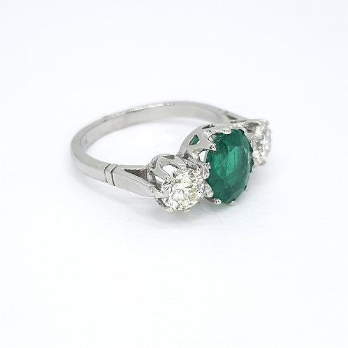 Emerald and diamond three stone ring.est.E1.73CTS D1.05CTS Platinum