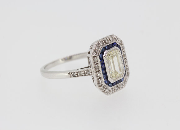 Calibre sapphire and emerald cut diamond ring.