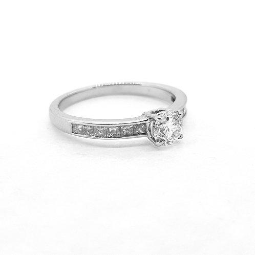 Single stone diamond ring with diamond shoulders CS0.52x0.43Cts