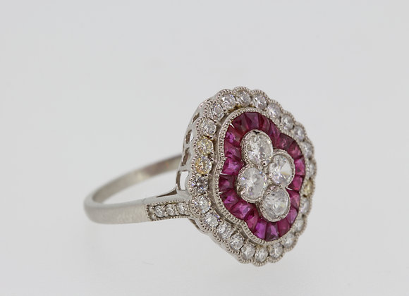 Platinum and ruby pave set ring