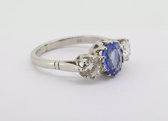 Sapphire and diamond three stone ring.