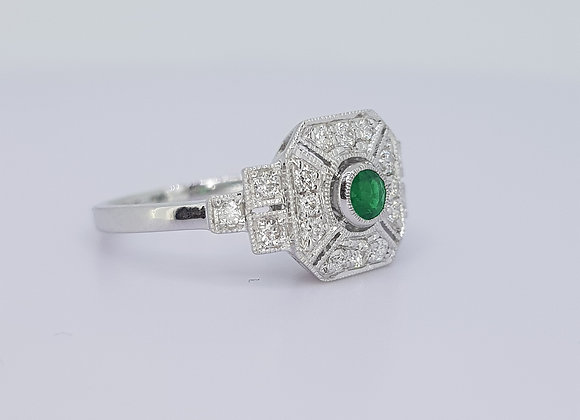 Emerald and diamond cluster ring.