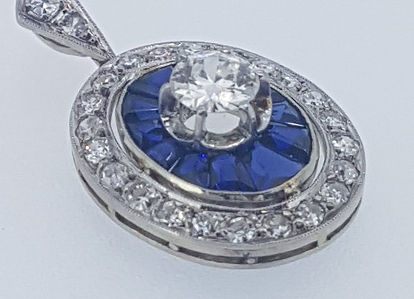 Calibre sapphire and diamond pendant.