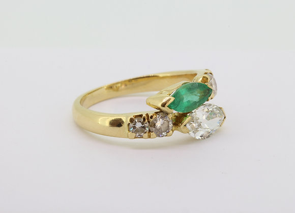 Emerald and diamond Xover ring.