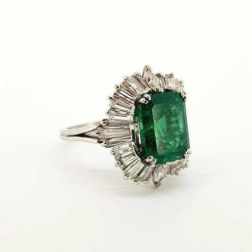 Platinum and emerald diamond ballerina ring.