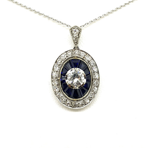 Calibre sapphire and diamond pendant.