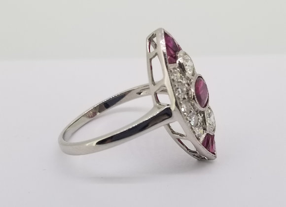 Ruby and diamond calibre set ring