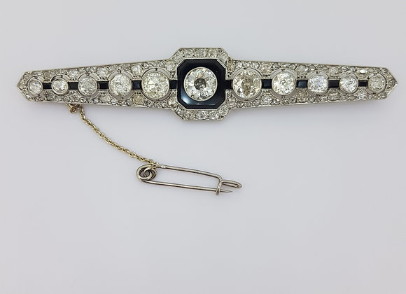 Onyx and diamond brooch est 6.0cts.