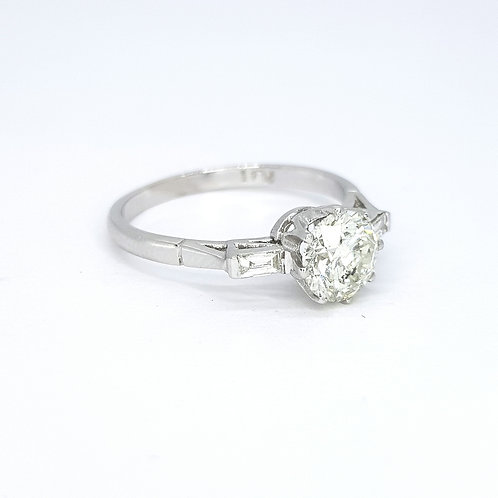 Solitaire diamond ring with baguette shoulders platinum D1.04CTS