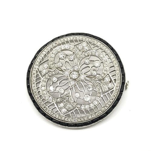 Art Deco diamond and onyx platinum brooch.