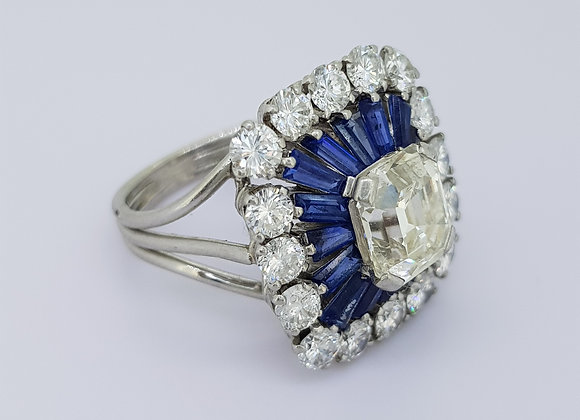 Emerald cut diamond and sapphire cluster ring.