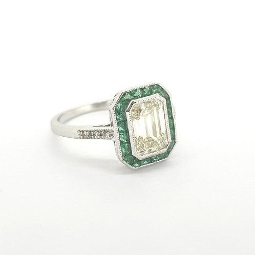 Calibre set emerald and emerald cut diamond ring D1.61Cts